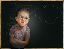 Emotional pupil boy near chalkboard Royalty Free Stock Photo