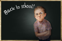 Emotional pupil boy near chalkboard Stock Photography