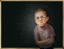 Emotional pupil boy near chalkboard Royalty Free Stock Photo