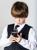 Emotional red-haired boy with mobile phone Royalty Free Stock Images