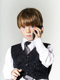 Emotional red-haired boy with mobile phone Royalty Free Stock Image