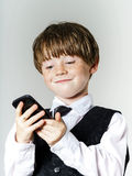 Emotional red-haired boy with mobile phone Stock Photo