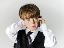 Emotional red-haired boy with mobile phone Royalty Free Stock Photos