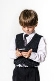Emotional red-haired boy with mobile phone Stock Photography