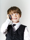 Emotional red-haired boy with mobile phone Royalty Free Stock Photography