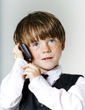 Emotional red-haired boy with mobile phone Royalty Free Stock Photo