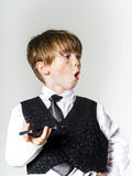 Emotional red-haired boy with mobile phone Stock Images