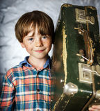 Emotional red-haired boy with suitcase Stock Photo