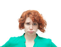 Emotional red-haired woman in doubt Royalty Free Stock Photos