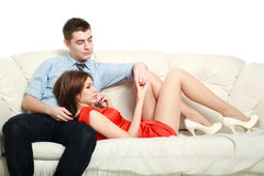 Emotional relationship, a young couple on the couch in thought Stock Photography