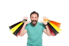 Emotional sales time. Men crazy about shopping. Extremely happy man with colored shopping bag in hands on white background. SALES! stock photos