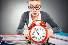 Emotional secretary with clock. Stock Photo