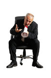 Emotional senior businessman with megaphone. Isolated on white background Royalty Free Stock Image