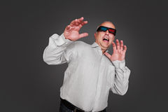 Emotional senior man in stereo glasses Royalty Free Stock Images