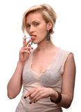 Emotional sexy woman posing with cigarette Stock Photos
