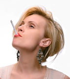 Emotional sexy woman posing with cigarette Royalty Free Stock Photography