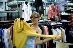 Emotional shopping. Young woman in glasses Royalty Free Stock Photo