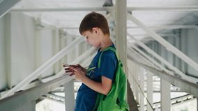 Emotional shots of the boy under the bridge. It stands on metal structures. Beautiful light and architecture stock video