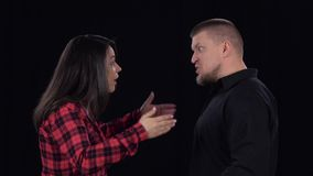 Emotional showdown between couple. Isolated on black background. Slow motion stock video