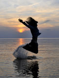 Emotional silhouette. Photo of a woman...jumping to water Royalty Free Stock Photos