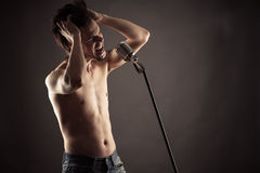 Emotional singer singing into retro microphone Royalty Free Stock Image