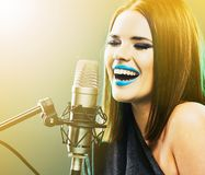 Emotional singer. Young woman. Royalty Free Stock Image