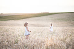 Emotional sisters on wheat field at sunset Stock Photography