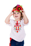 Emotional small girl with ukranian wreath. Emotional small girl with ukranian wreath on white background Stock Photography