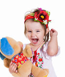 Emotional small girl with ukranian wreath. Stock Photos