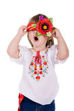 Emotional small girl with ukranian wreath. Royalty Free Stock Photos