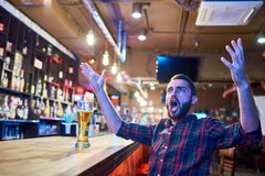 Emotional Sports Fan in Pub royalty free stock photography