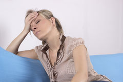 Emotional Stress, Headache, Woman at home on the sofa.  Stock Image