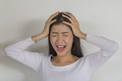 Emotional stress. Sad emotions,Negative human emotions, facial expressions, feeling, attitude, behavior,Feeling tired and stressed. Frustrated Asian woman royalty free stock images