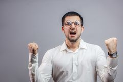 An emotional successful man is shouting as he has bought a new house royalty free stock photo