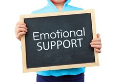 Emotional Support concept depicted. Emotional Support concept depicted with child holding blackboard with text royalty free stock photos