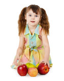 Emotional surprised girl with apples sit on white Stock Photo