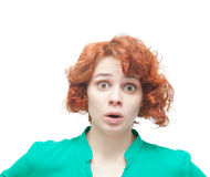 Emotional surprised red-haired woman Royalty Free Stock Image