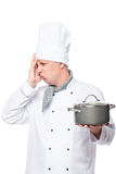 Emotional upset unsuccessful dish cook in a pot on a white Royalty Free Stock Photo