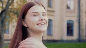 Emotional video-portrait of a winking beautiful young girl stock video footage