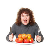 Emotional woman with apples stock image