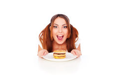 Emotional woman with burger Royalty Free Stock Images