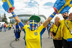 Emotional woman fan supporting of Sweden national football team. stock image