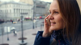 Emotional woman having a phone talk outdoor stock video