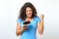 Emotional woman holding a broken mobile phone Stock Photos