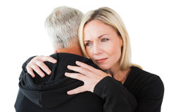 Emotional woman hugging her partner Royalty Free Stock Photo