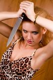 Emotional woman with kitchen knife Royalty Free Stock Photography
