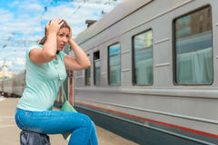 Emotional woman looks at the departing train Stock Photography