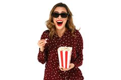 Emotional woman with popcorn watching blockbuster movie in stereo glasses. Emotional young woman with popcorn watching blockbuster movie in stereo glasses Royalty Free Stock Image