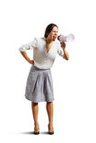 Emotional woman shouting at megaphone Stock Photos