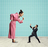 Emotional woman and small man Stock Images
